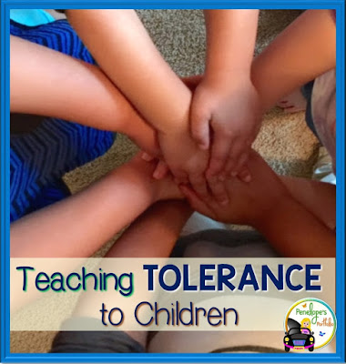 Four children forming a circle and placing their hands together to show unity and tolerance
