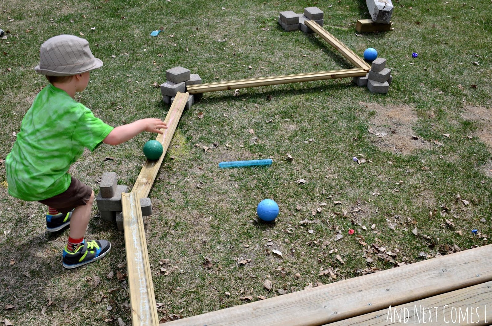DIY outdoor ball run for kids: building with loose parts in the backyard from And Next Comes L