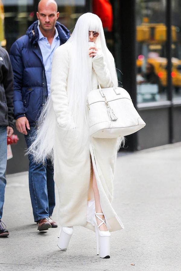 Another wearing white heavy winter jacket in New York City.