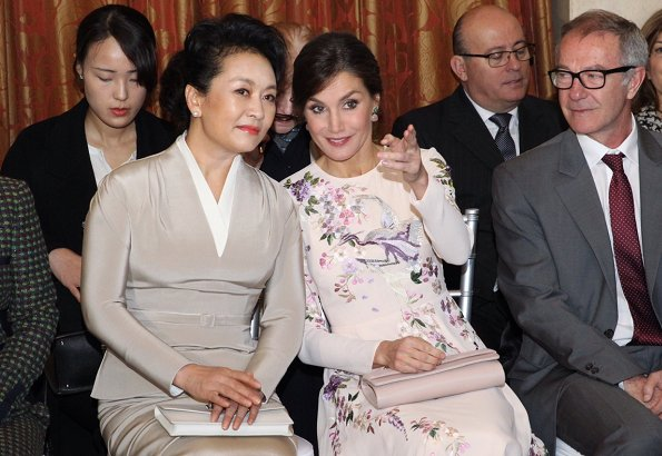 Queen Letizia wore ASOS DESIGN Tall midi dress with pretty floral and bird embroidery.  First Lady Peng Liyuan. Carolina Herrera coat
