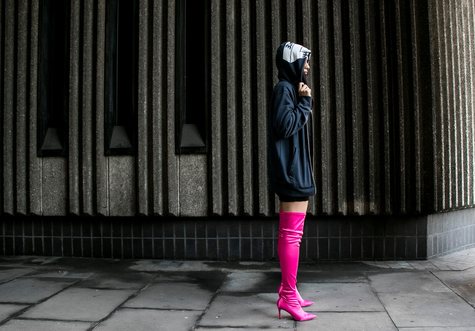 Palace hoodie and over the knee boots worn by fashion blogger Reena Rai