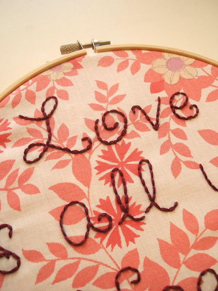 hand embroidering beatles lyrics onto vintage fabric
