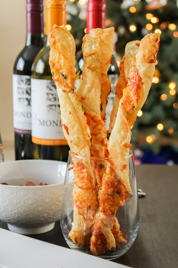 These Italian Cheese Straws are simple to make and are a delicious holiday appetizer! Pair them with a few other festive treats and a couple bottles of wine, and you've got everything you need for the perfect holiday party!