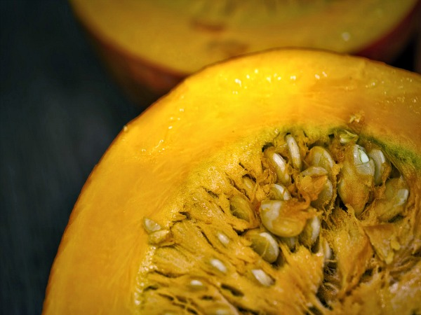 Carved pumpkin with seeds from Walking on Sunshine Recipes.
