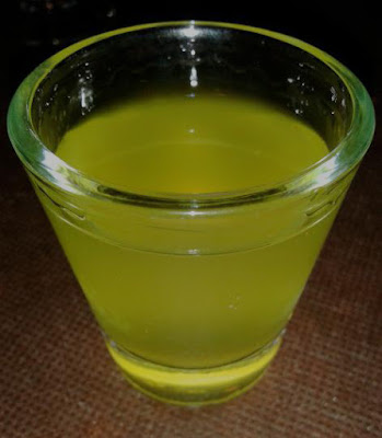 Shot_glass_of_limoncello_close-up.jpg