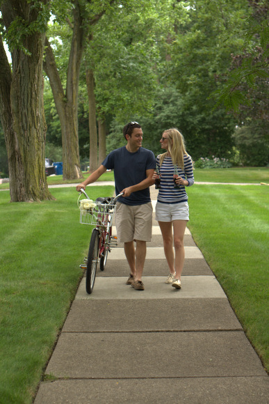 These old fashioned engagement pictures with a tandem bike and antique soda bottles are adorable.