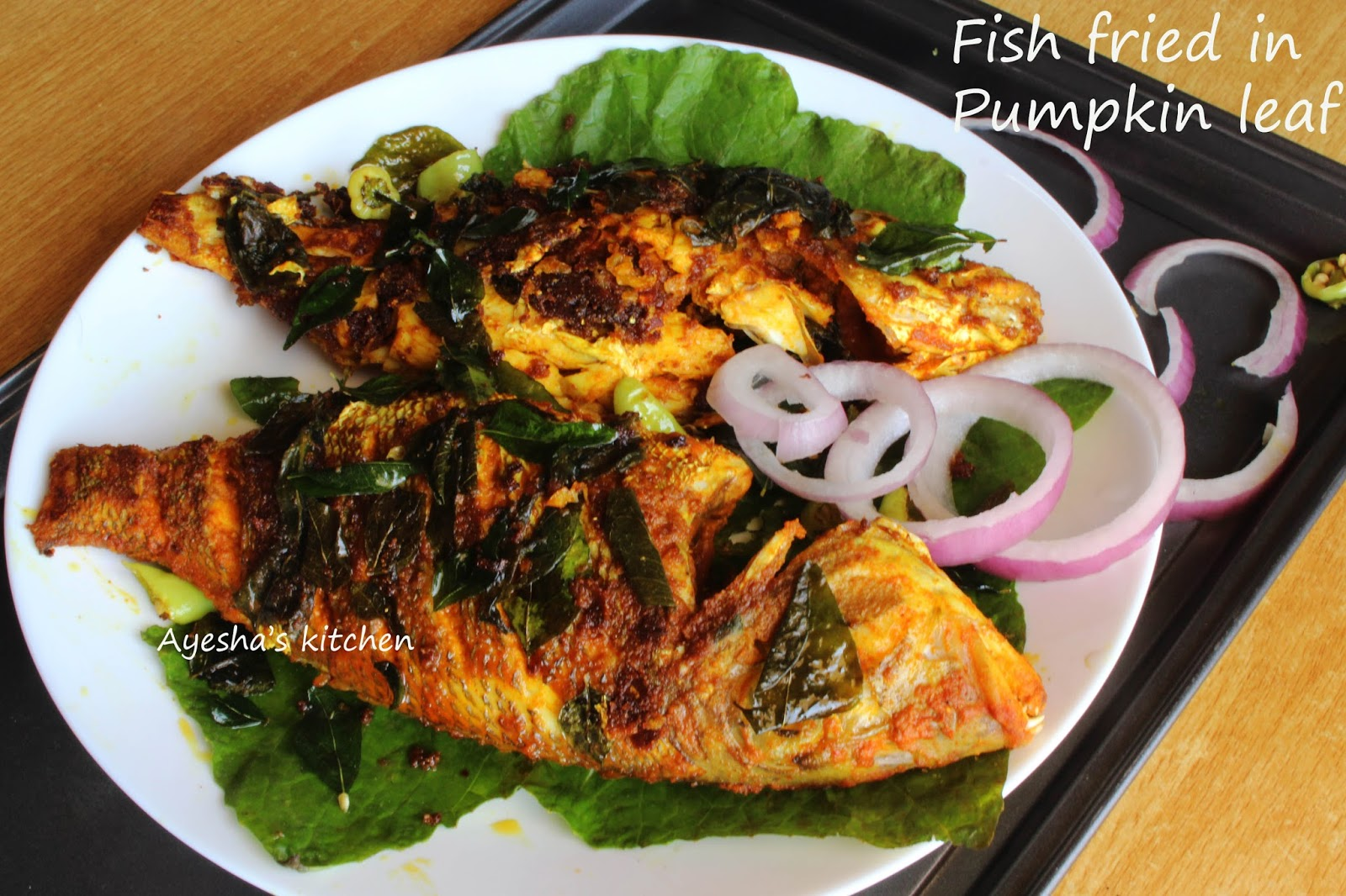 Pan fried fish fish fry recipe in pumpkin leaf whole for Frying fish recipes