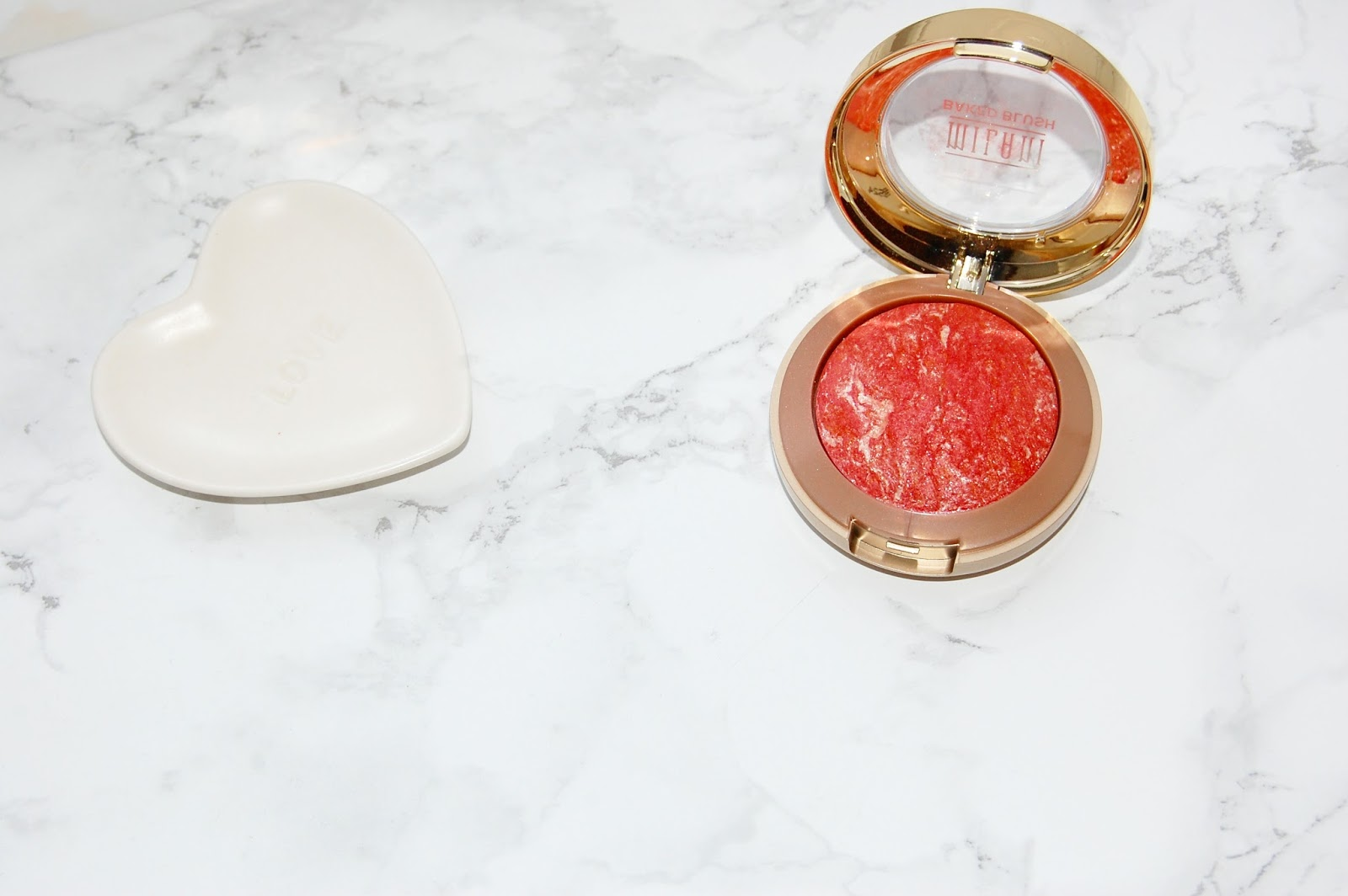 See my review of Milani Baked Blush in Corallina