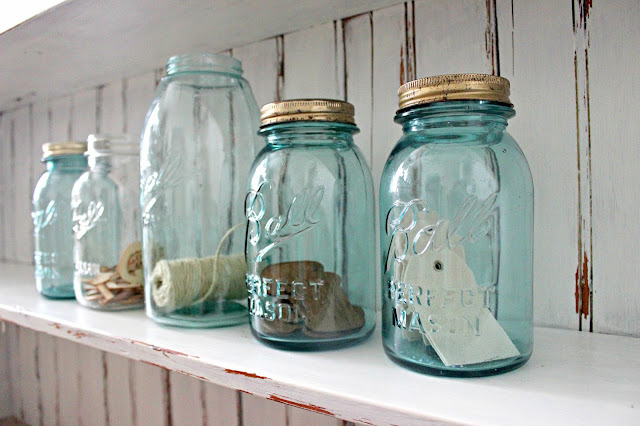 Blue mason jars and white, chippy distressed wood; a pair made in heaven.
