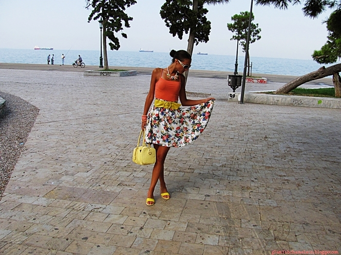 Vitage floral skirt, orange top, yellow bag and mules