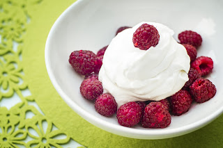 Bowl of Raspberries with Whipped Cream