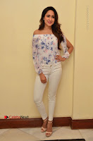 Actress Pragya Jaiswal Latest Pos in White Denim Jeans at Nakshatram Movie Teaser Launch  0010.JPG