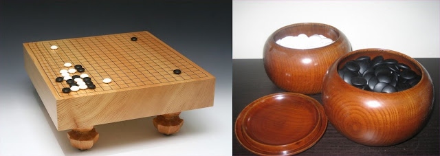 Traditional 19x19 Goban (left) and Go stones (right).