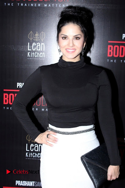 Bollywood Model Actress Sunny Leone Stills in White Skirt at Body Sculptor Gym Launch  0001.jpg