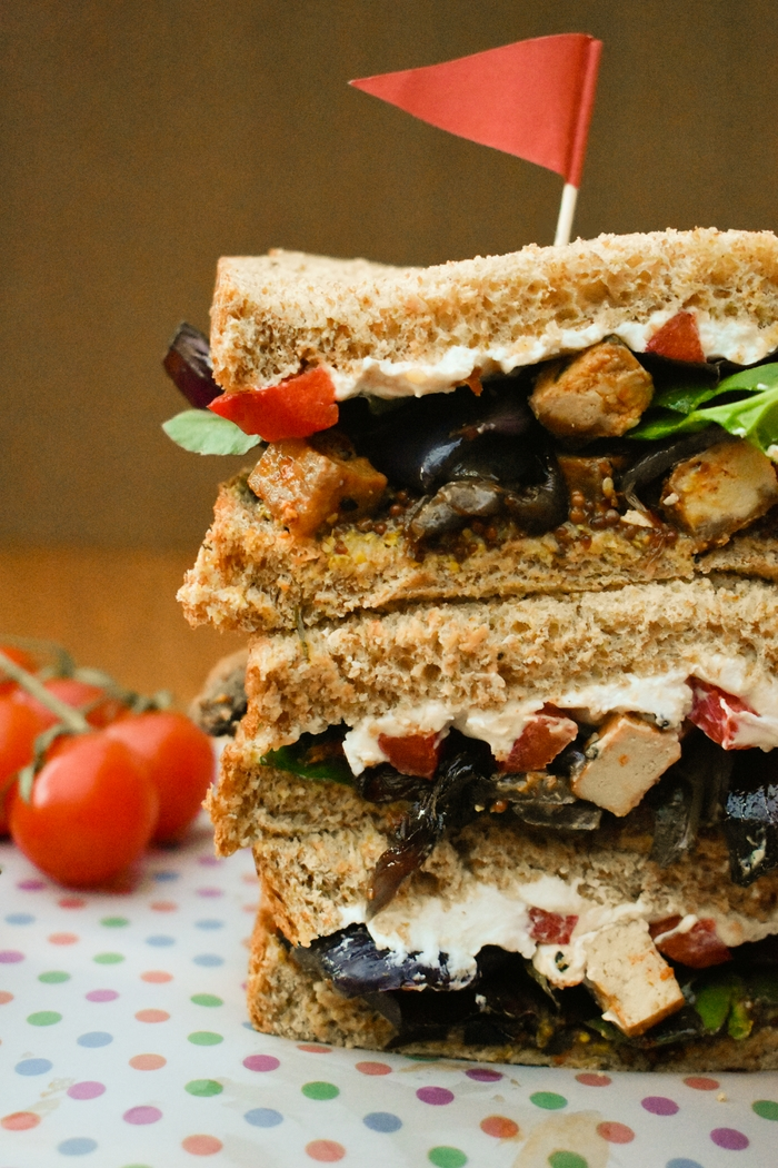 Roasted Vegetable and Tofu Sandwiches. A recipe for luxurious veggie sandwiches. Soft wholemeal bread filled with mustard, salad leaves, roasted vegetables and tofu and cream cheese, plus a meal prep guide. #sandwiches #roastedvegetables #roasttofu #tofu #vegan #veganlunch #veggielunch #vegetarianlunch #sandwiches #vegansandwiches #sandwichideas #lunchbox #packedlunch