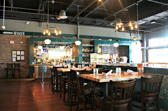 Punch Bowl Social's main dining area is open and inviting while being a bit swanky.