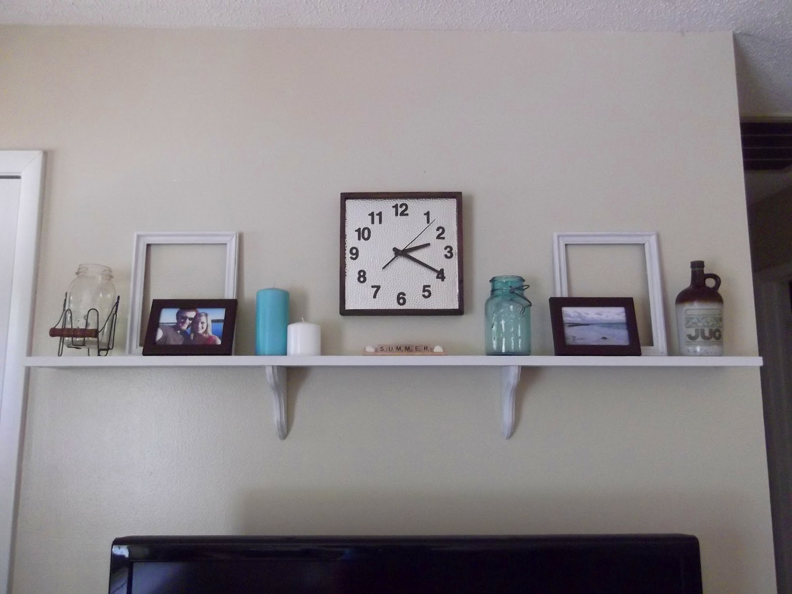 Thrifty 31 blog new shelf above tv for Long wall decoration living room