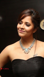 Telugu Anchor Actress Anasuya Bharadwa Stills in Strap Less Black Long Dress at Winner Pre Release Function  0016.jpg