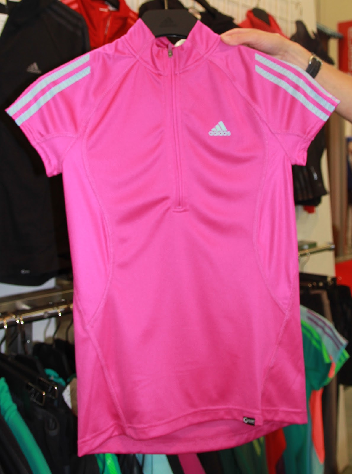 17be0309 W Terrex Swift Half Zip S/S $50 w/ fitted collar- in a Vivid Pink-made of  Cocona