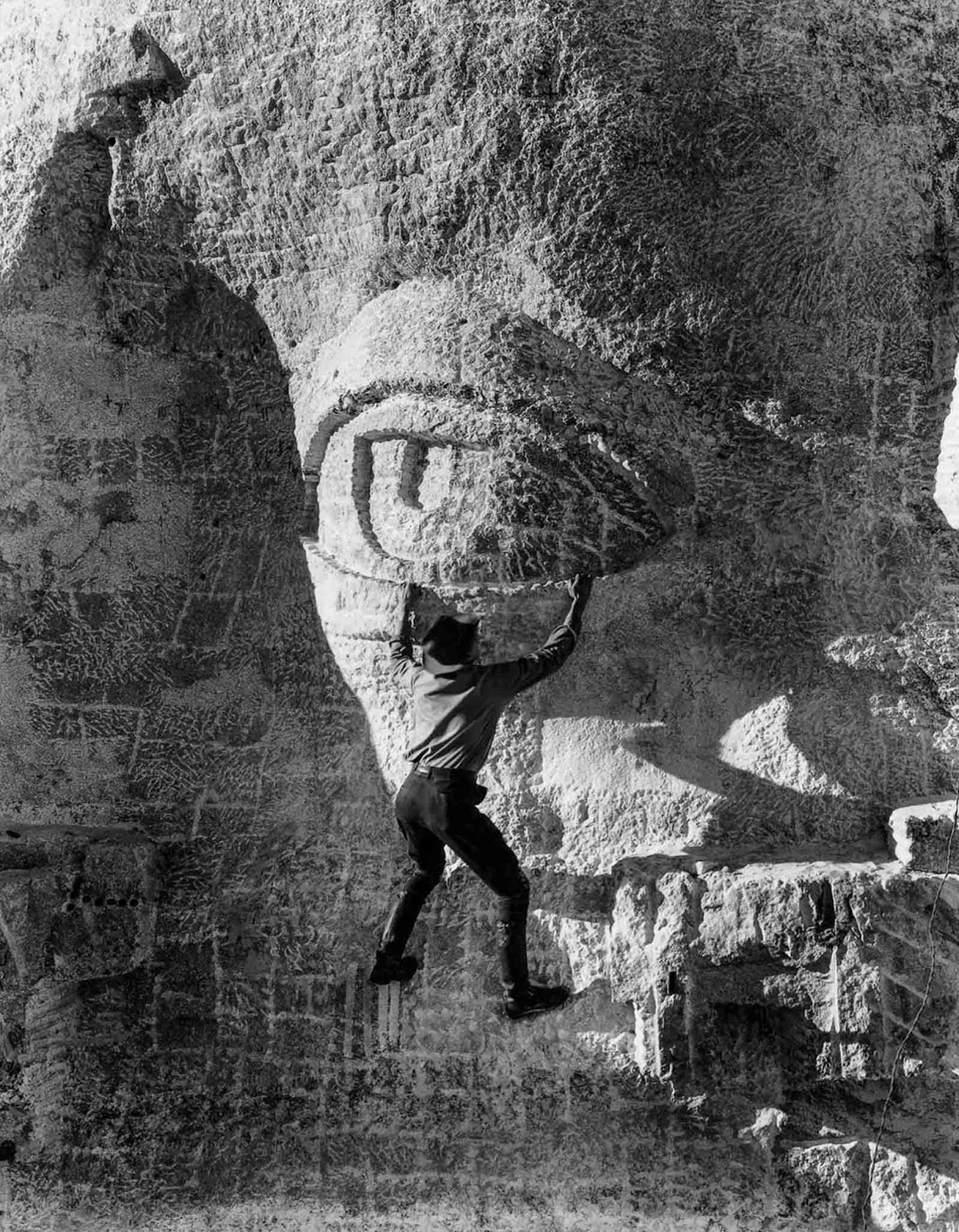A stone carver hangs on to Thomas Jefferson's eyelid. 1936.