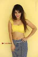 Cute Telugu Actress Shunaya Solanki High Definition Spicy Pos in Yellow Top and Skirt  0507.JPG