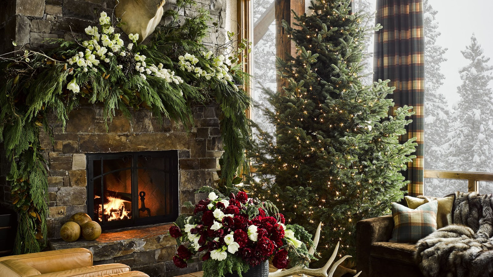 Beautiful Christmas decorated mantel and living room by Ken Fulk in Montana ski house - Hello Lovely Studio