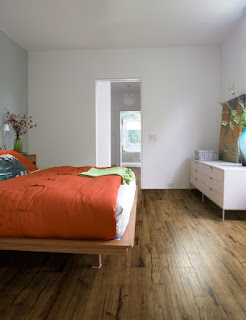 Scraped hardwood flooring in bedroom