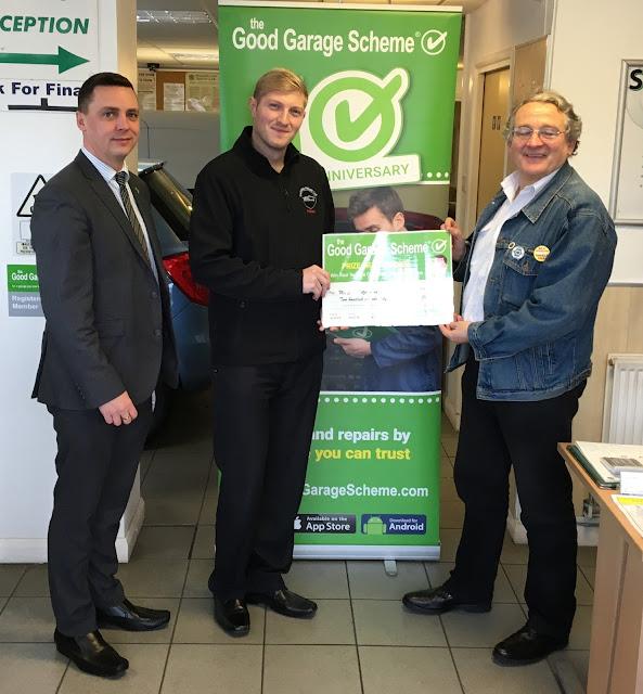 Presentation photo with Good Garage Scheme regional manager and winner at Saunders Abbott