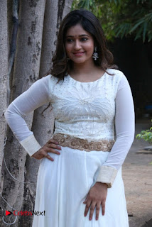 Actress Poonam Bajwa Pictures in White Dress at Muthina Kathirikai Movie Audio Launch  0005