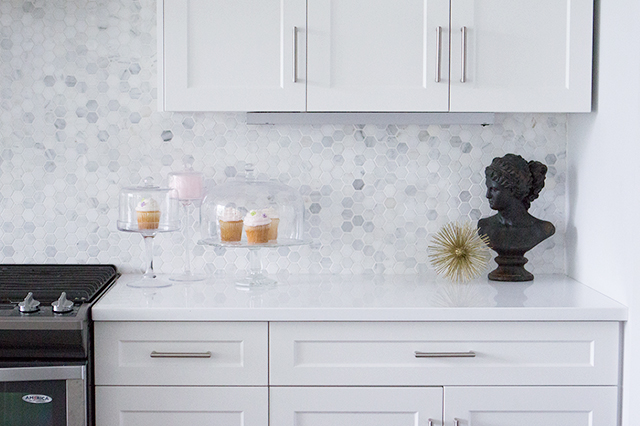 Blogger home reveal: Beautiful white kitchen with marble hexagon tile.