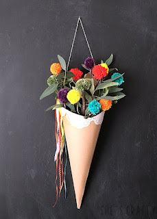 Freshen up your space for Spring with a colorful wall hanging - how to hang a paper cone