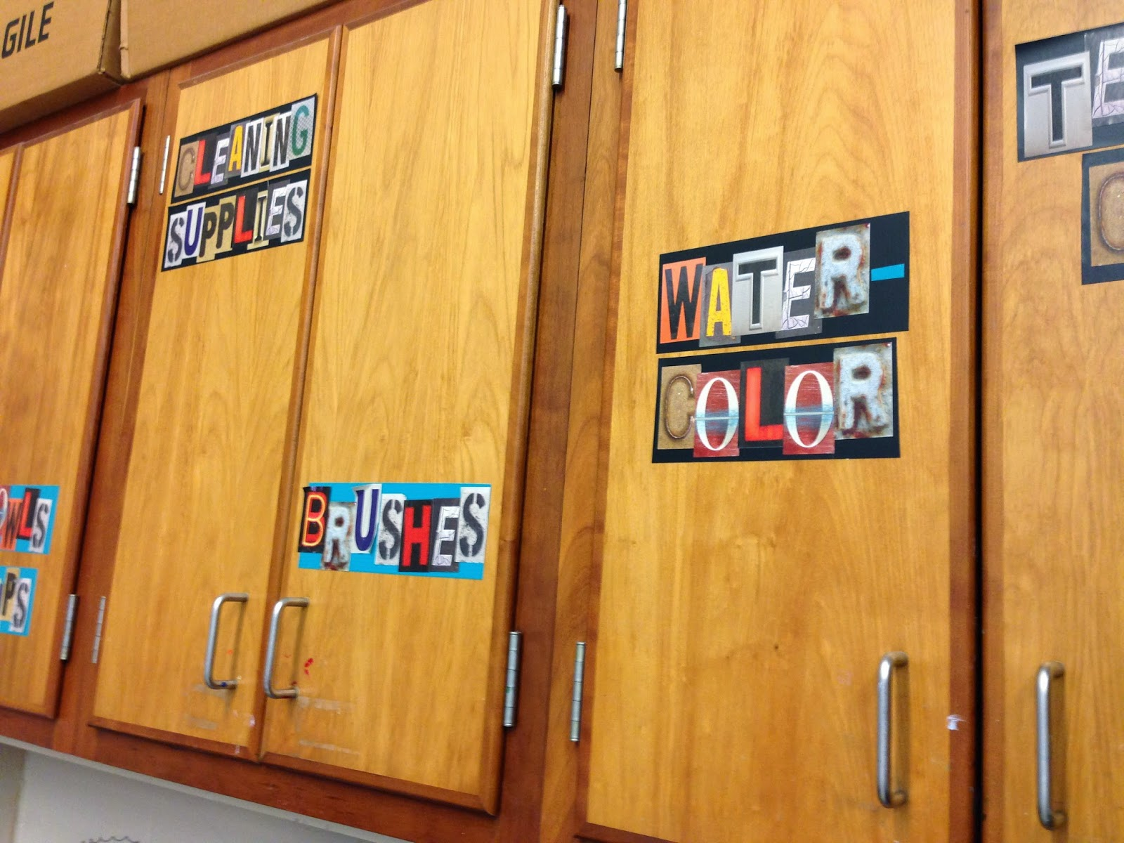 Use letter stickers for labeling cabinets.