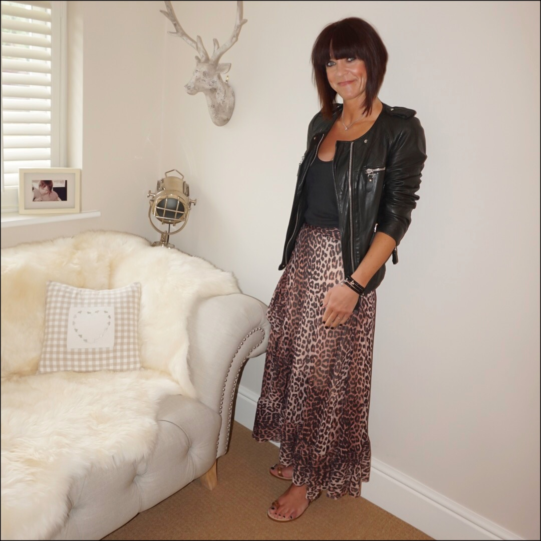 my midlife fashion, isabel marant etoile biker jacket, and other storied ribbed tank top, ganni leopard print mesh frill wrap skirt, basalt sarah summer cuoio studded sandals
