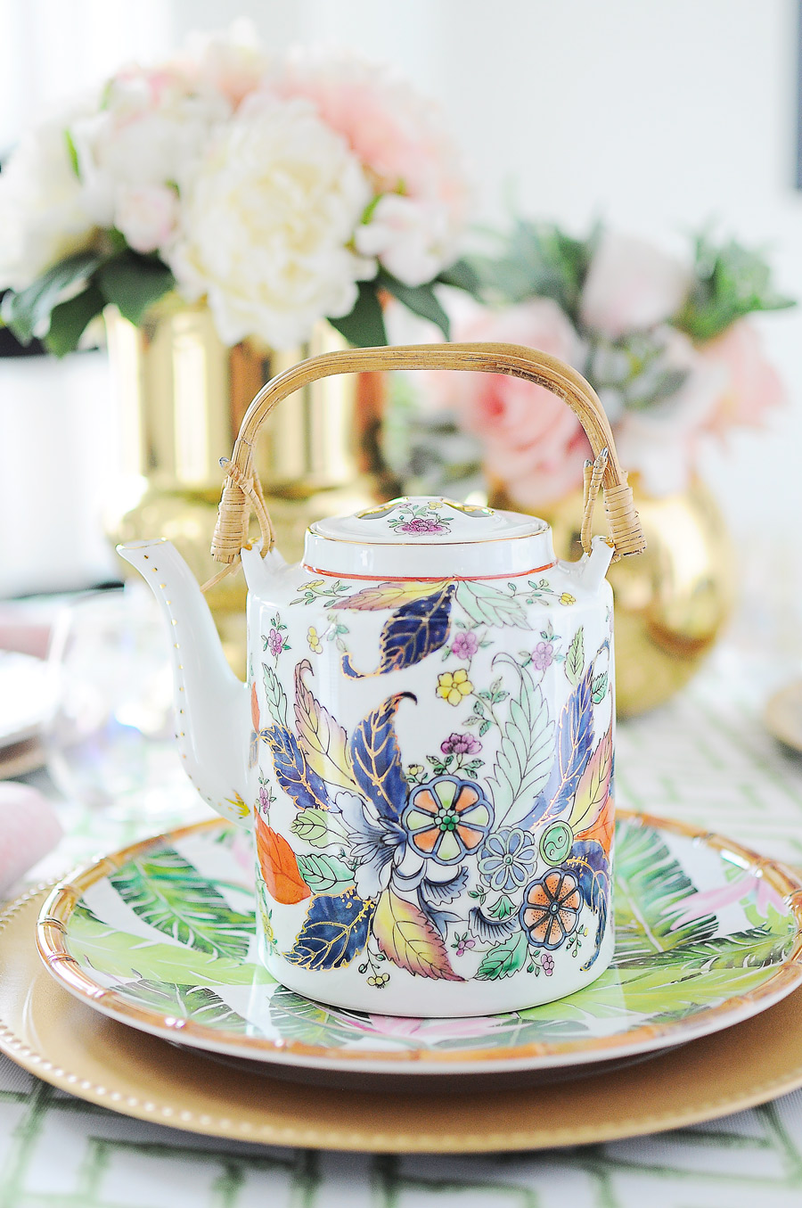 A gorgeous tobacco leaf teapot on a pink, green, white and gold chinoiserie inspired tablescape.