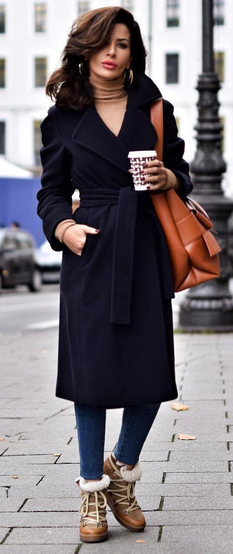 fashionable outfit / black coat + brown bag + jeans + boots