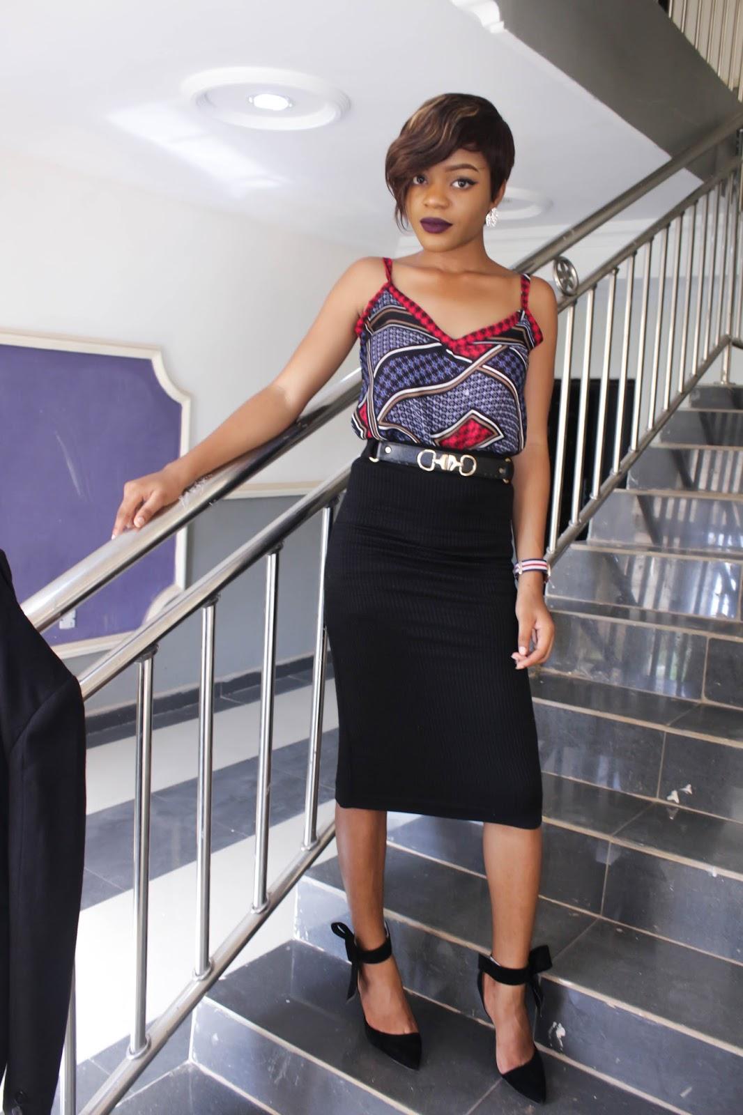 purple ankara like blouse and pencil skirt
