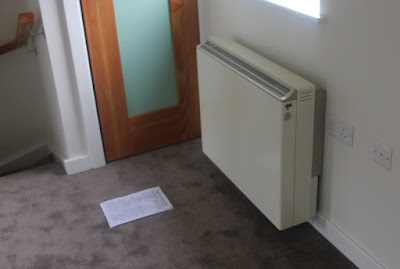 A storage heater charged by solar electricity.