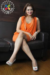 South Indian Actress Saloni Aswani Hot Boobs and Thighs in Mini Orange Dress Photos at Meelo Evaru Koteeswarudu press meet - NetLogsHub