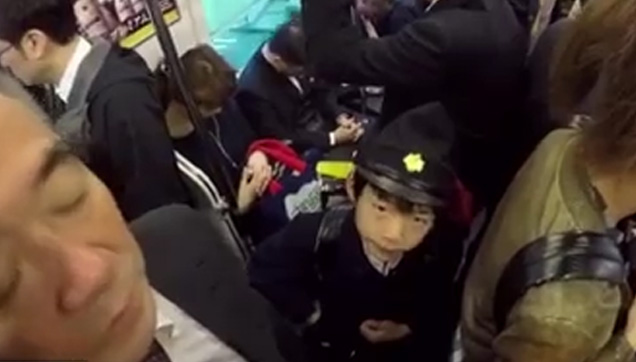 Ryuhei Sato inside the train on his way to school.