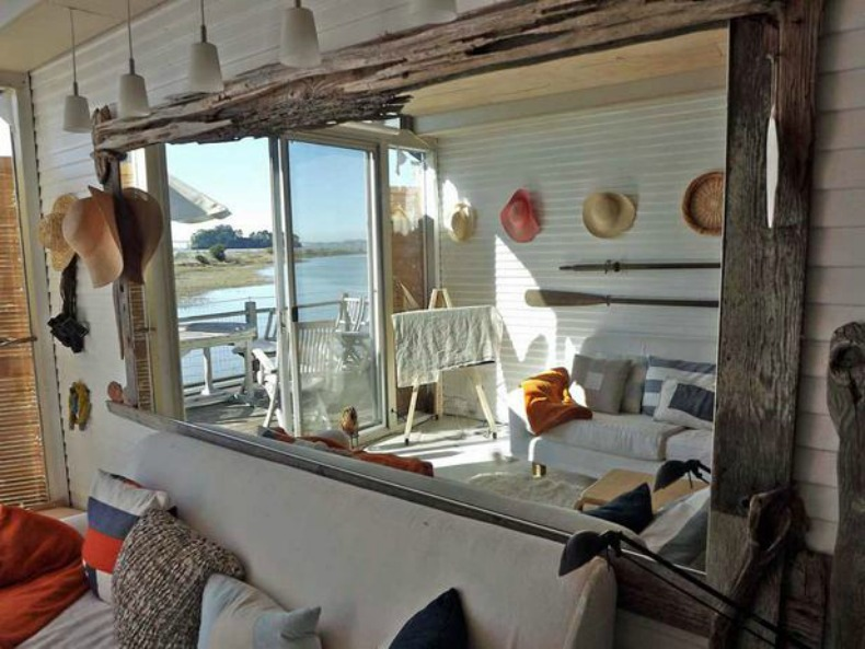 driftwood mirror, white slipcover sofas, navy and white pillows