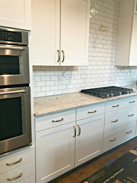 white cabinets brass hardware