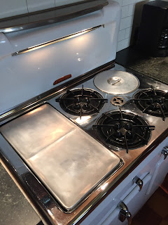 A polished griddle on a vintage Chambers stove model 90c