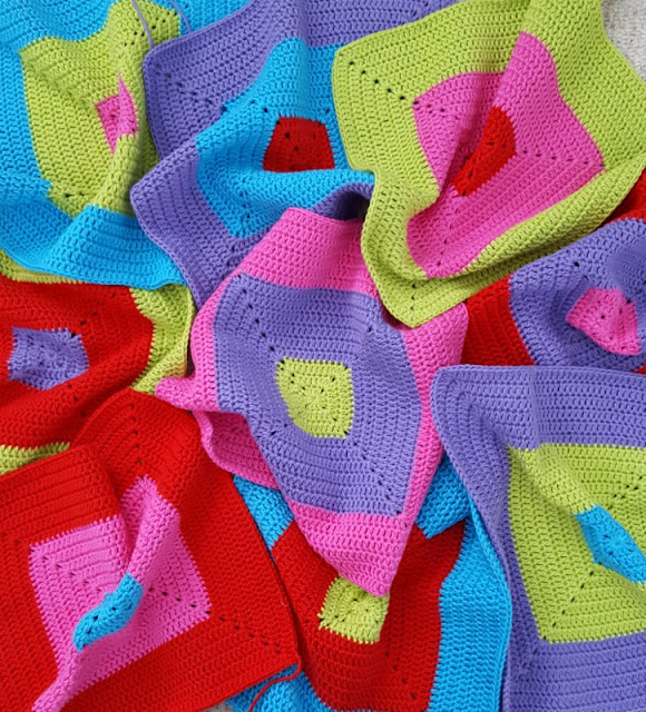 Looking for a bright bold colour block crochet design?  Click to see more of this colourful crochet blanket as it takes shape!