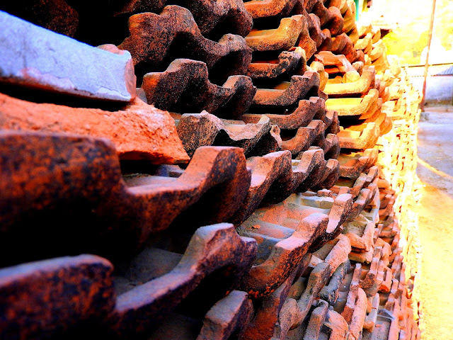 Pile of house roof tiles on the village walk | Adgaon, Maharashtra - India