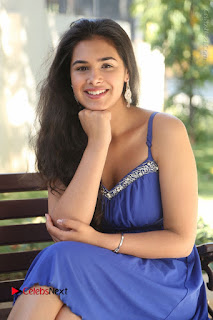 Actress Prasanna Stills in Blue Short Dress at Inkenti Nuvve Cheppu Movie Platinum Disc Function  0126.JPG