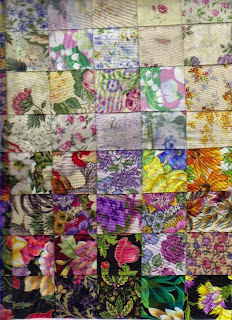 Watercolor quilt with flower patterns in light to dark hues