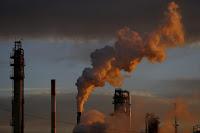 Smoking chimneys (Credit: Luke Sharrett/Bloomberg) Click to Enlarge.