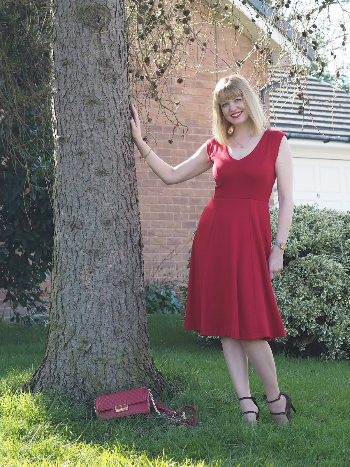 Alie Street fifties style chilli red Olivia dress with gold bee jewellery