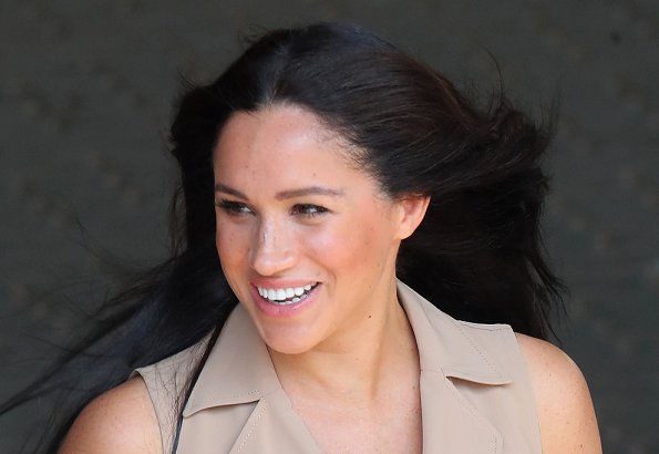 Meghan Markle wore a new double breasted trench dress by Banana Republic and legend suede pumps by Stuart Weitzman