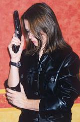 Secret agent girl in leather with a gun
